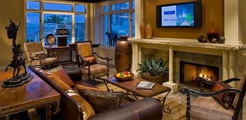 City Fireplace living room property building home recreation room cottage Suite mansion cluttered