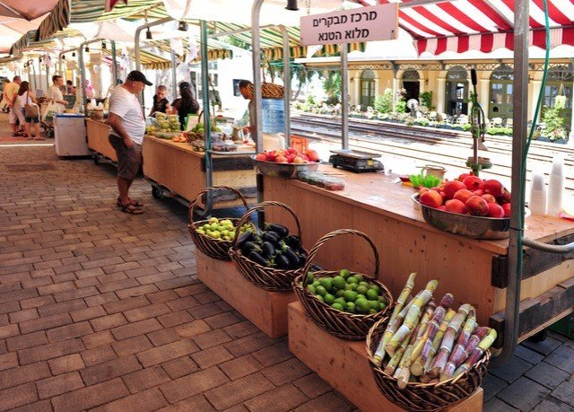marketplace public space City market vendor floristry grocery store greengrocer food retail stall