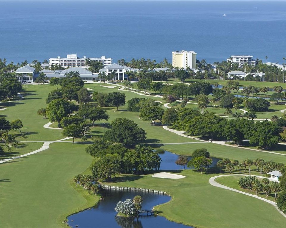 Golf Ocean grass structure aerial photography bird's eye view sport venue golf course residential area Nature outdoor recreation sports golf club City Resort recreation overlooking hillside land Island lush