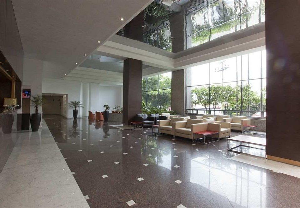 City Lobby Lounge property building hardwood condominium home flooring daylighting living room wood flooring professional Island