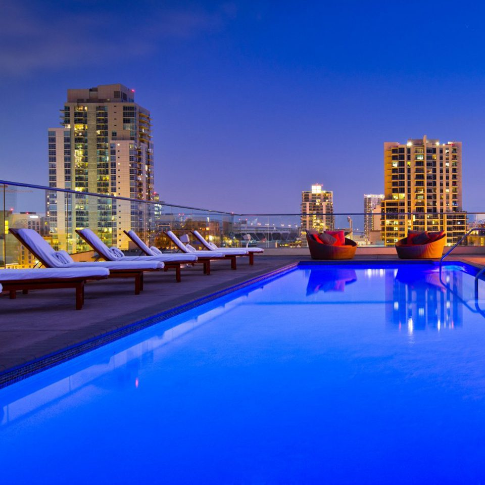 City Lounge Luxury Pool Scenic views sky swimming pool night evening dusk cityscape Resort skyline
