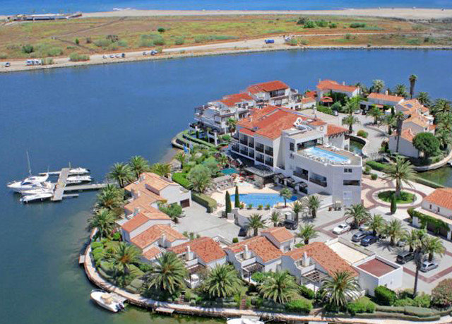 water marina mountain property dock bird's eye view Nature Resort aerial photography residential area port City shore