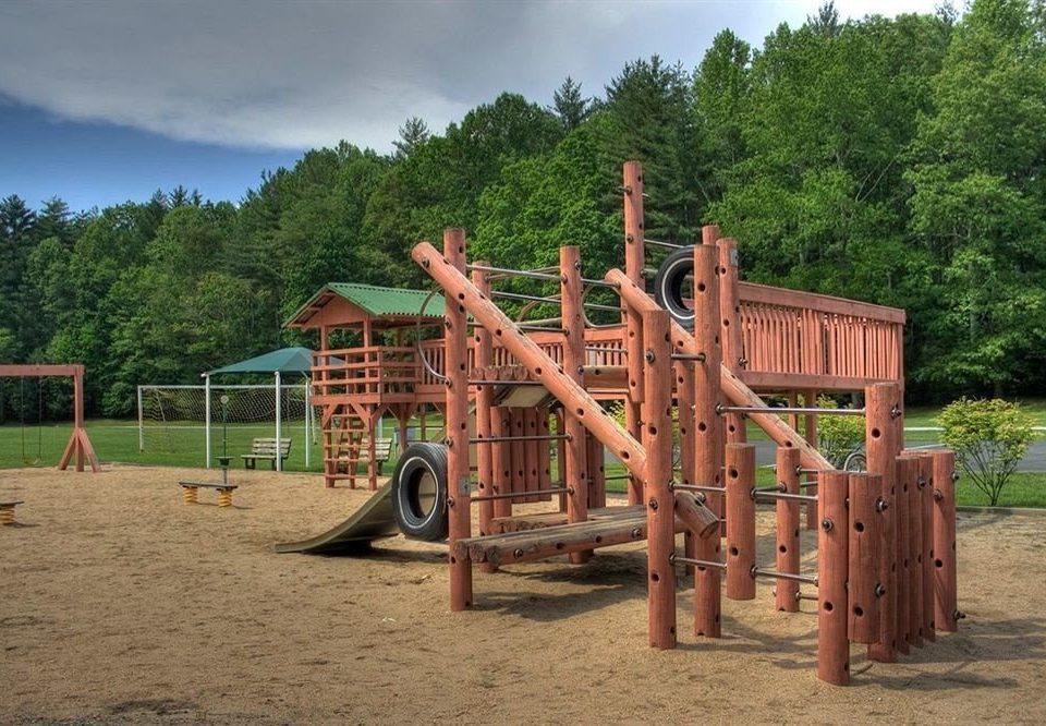 tree ground sky Playground City outdoor play equipment public space wooden Play outdoor recreation recreation backyard dirt