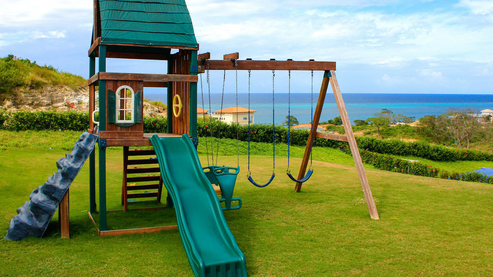grass sky outdoor play equipment City leisure Playground public space green Play playground slide swing overlooking seat chair lush