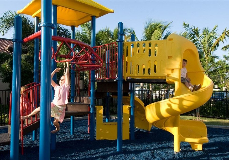 sky tree Playground outdoor play equipment City public space yellow leisure Play recreation outdoor recreation playground slide park jungle gym