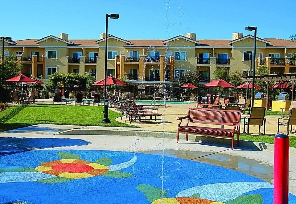 sky building grass leisure Playground lawn City Resort public space Town outdoor play equipment Play swimming pool house plaza Water park backyard town square Pool walkway park colorful