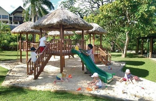 tree grass ground Playground outdoor play equipment public space City chair lawn Play Resort outdoor recreation backyard recreation shade