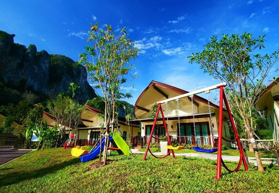grass tree sky leisure City public space Playground house Play Resort outdoor play equipment colorful Village backyard