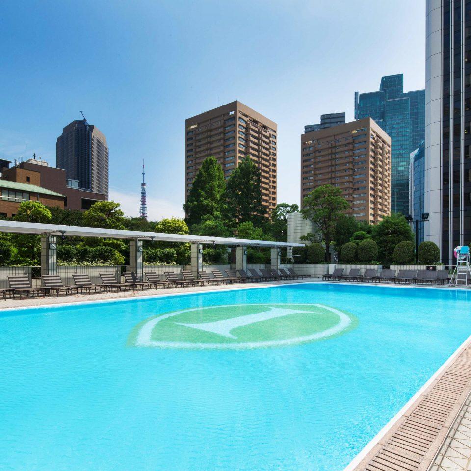 Pool building condominium swimming pool property Resort reflecting pool blue City swimming