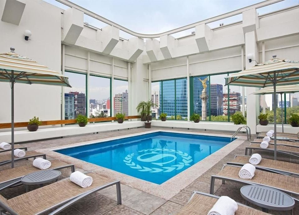 City Pool Scenic views swimming pool property condominium leisure leisure centre Resort Villa counter home mansion