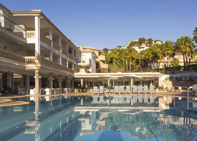 building property swimming pool Resort plaza condominium palace resort town marina City mansion lined apartment building