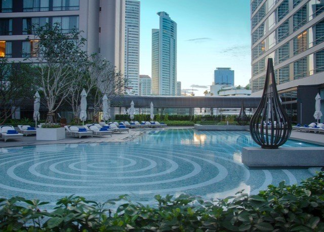 building condominium swimming pool property plaza reflecting pool Resort City residential area