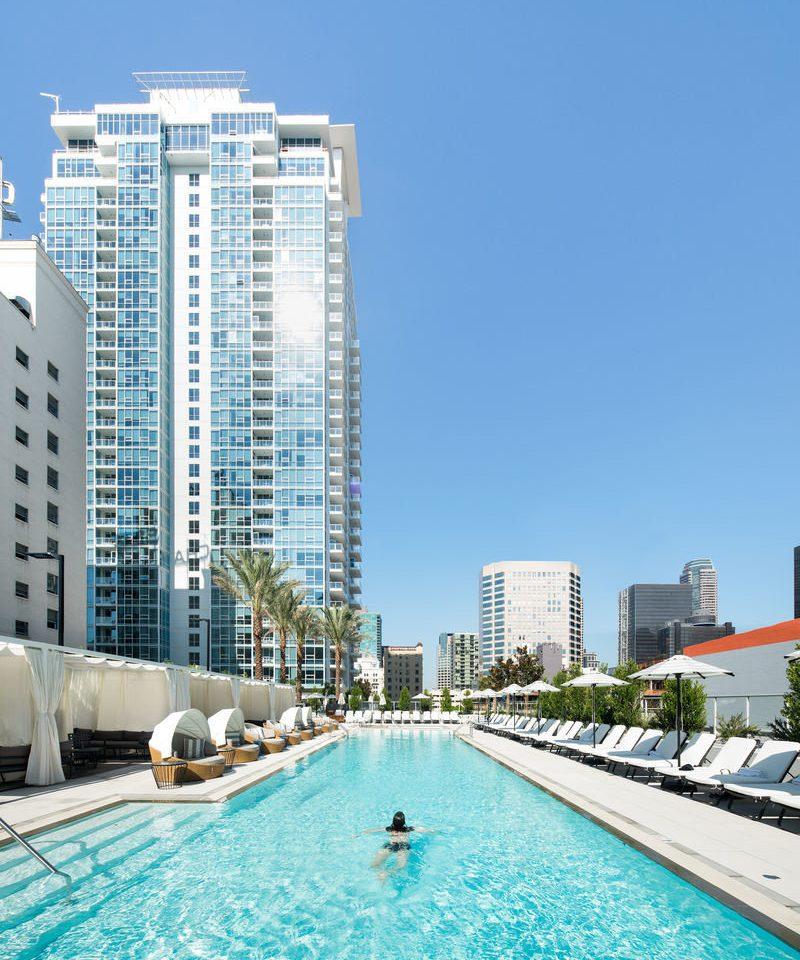 sky condominium property leisure swimming pool marina tower block City Resort dock day