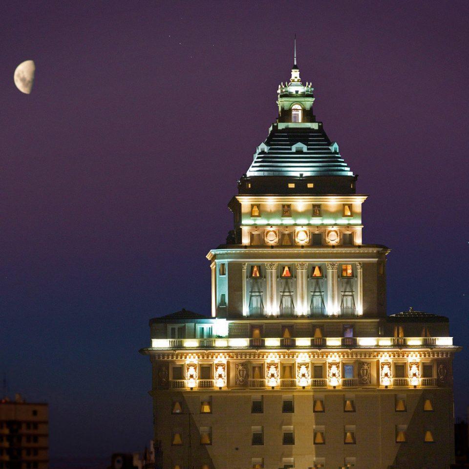 night landmark tower light evening dusk cityscape skyscraper lit metropolis skyline