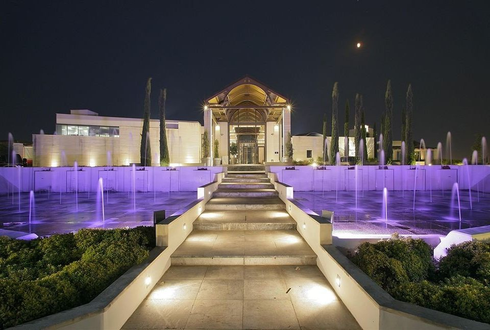 landmark night reflecting pool fountain lighting water feature plaza cityscape
