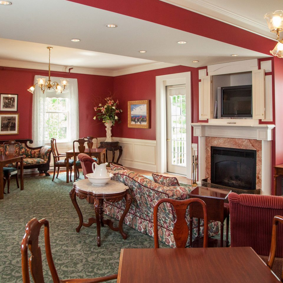 Classic Country Fireplace Inn Lounge chair property Dining restaurant red home living room function hall recreation room Lobby Resort