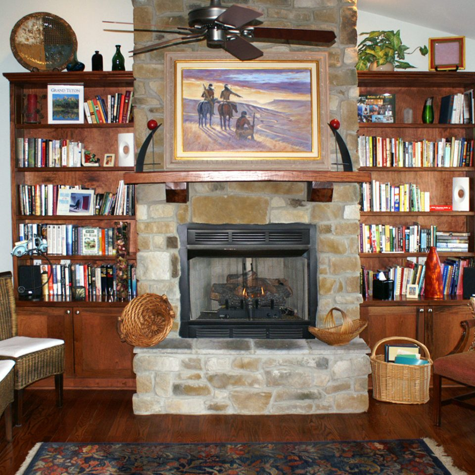 Classic Country Fireplace Inn Lounge shelf book living room property home building house cottage cabinetry