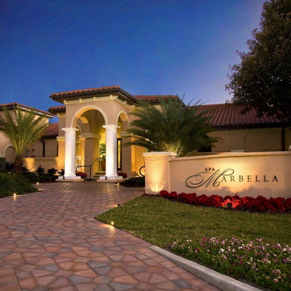 Classic Exterior Resort grass tree sky property house building home hacienda Villa mansion brick Courtyard stone walkway