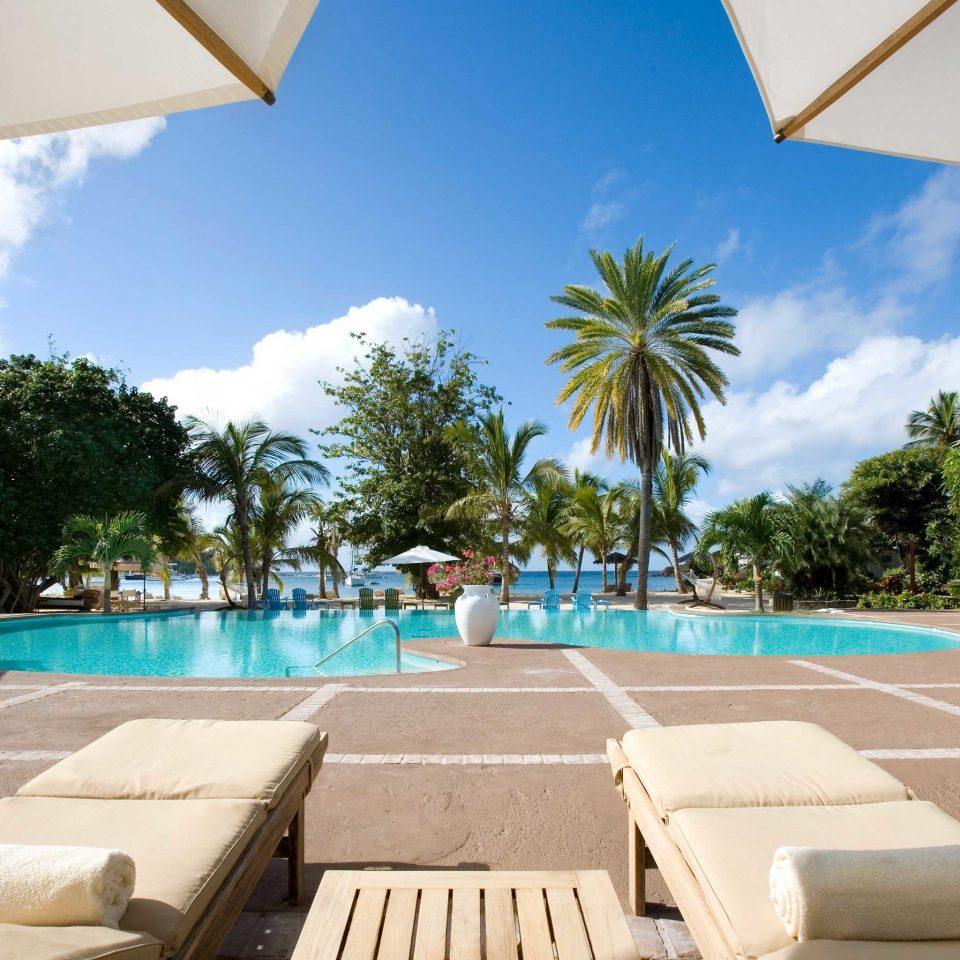 Classic Inn Play Pool sky tree swimming pool Resort property leisure caribbean Villa condominium Deck palm shade