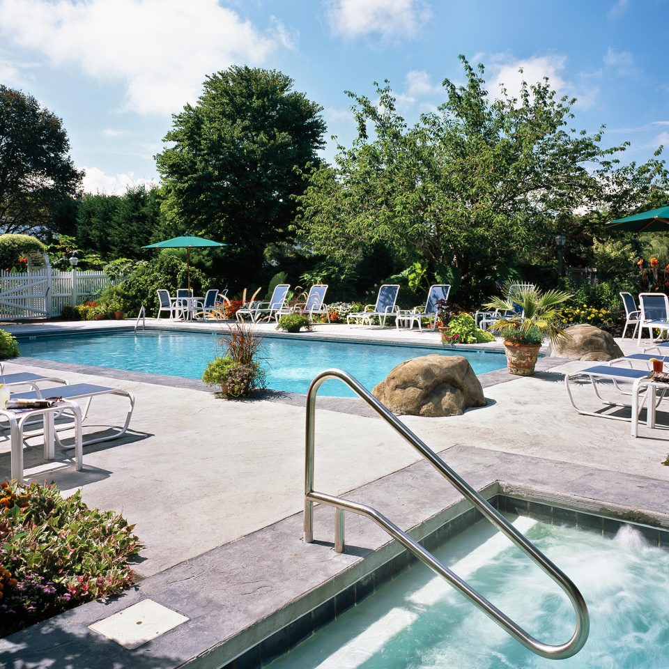 Classic Inn Pool Romantic Spa Waterfront Wellness tree sky leisure swimming pool Resort Water park backyard Villa park lined sunny Deck day