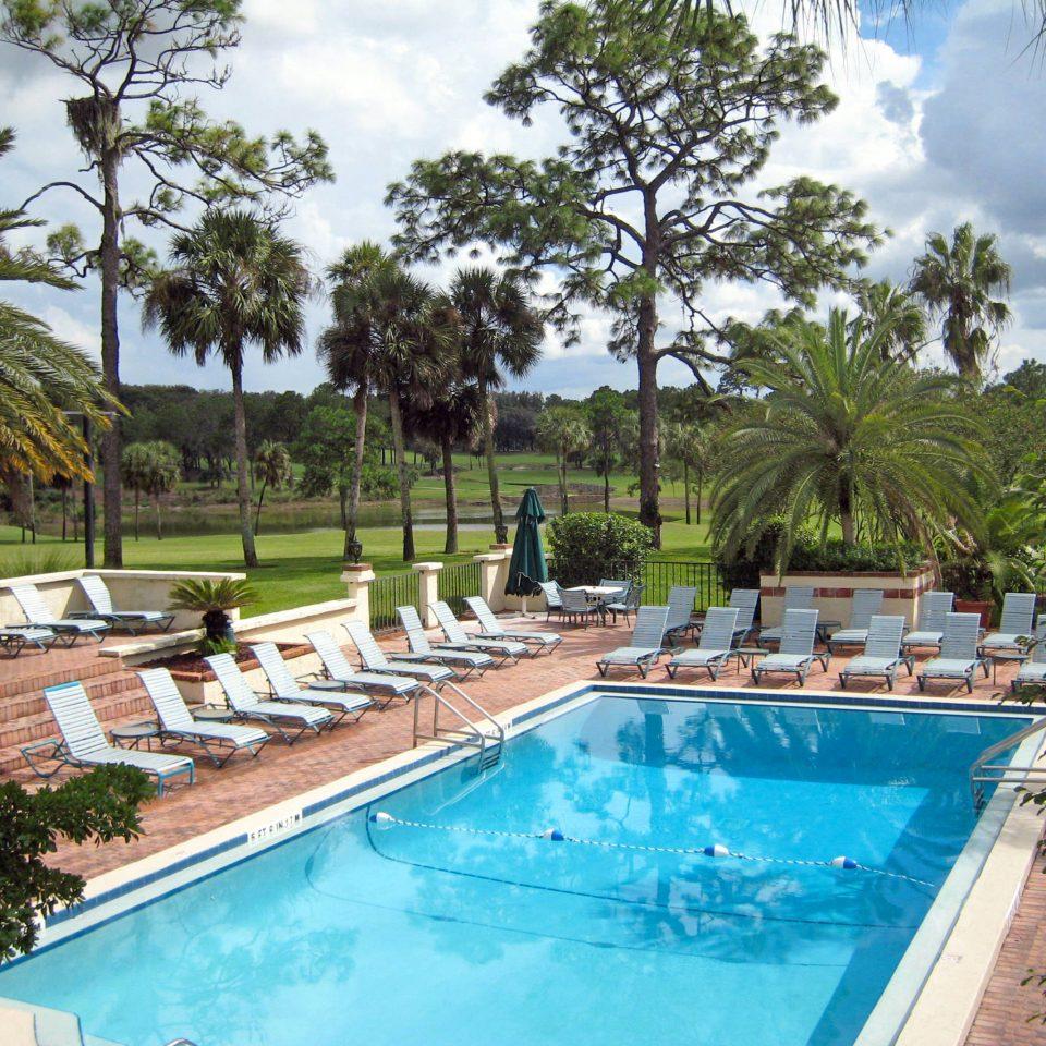 Classic Deck Lounge Patio Pool Resort Terrace tree swimming pool property Villa reflecting pool backyard condominium mansion hacienda