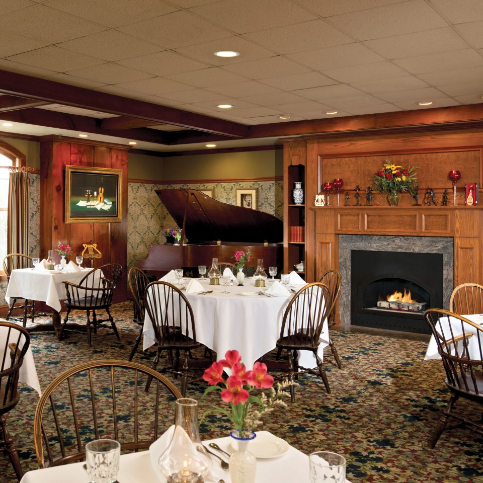 Classic Dining Drink Eat Fireplace Inn Romantic Spa Waterfront chair function hall banquet wedding ceremony ballroom restaurant wedding reception Party conference hall
