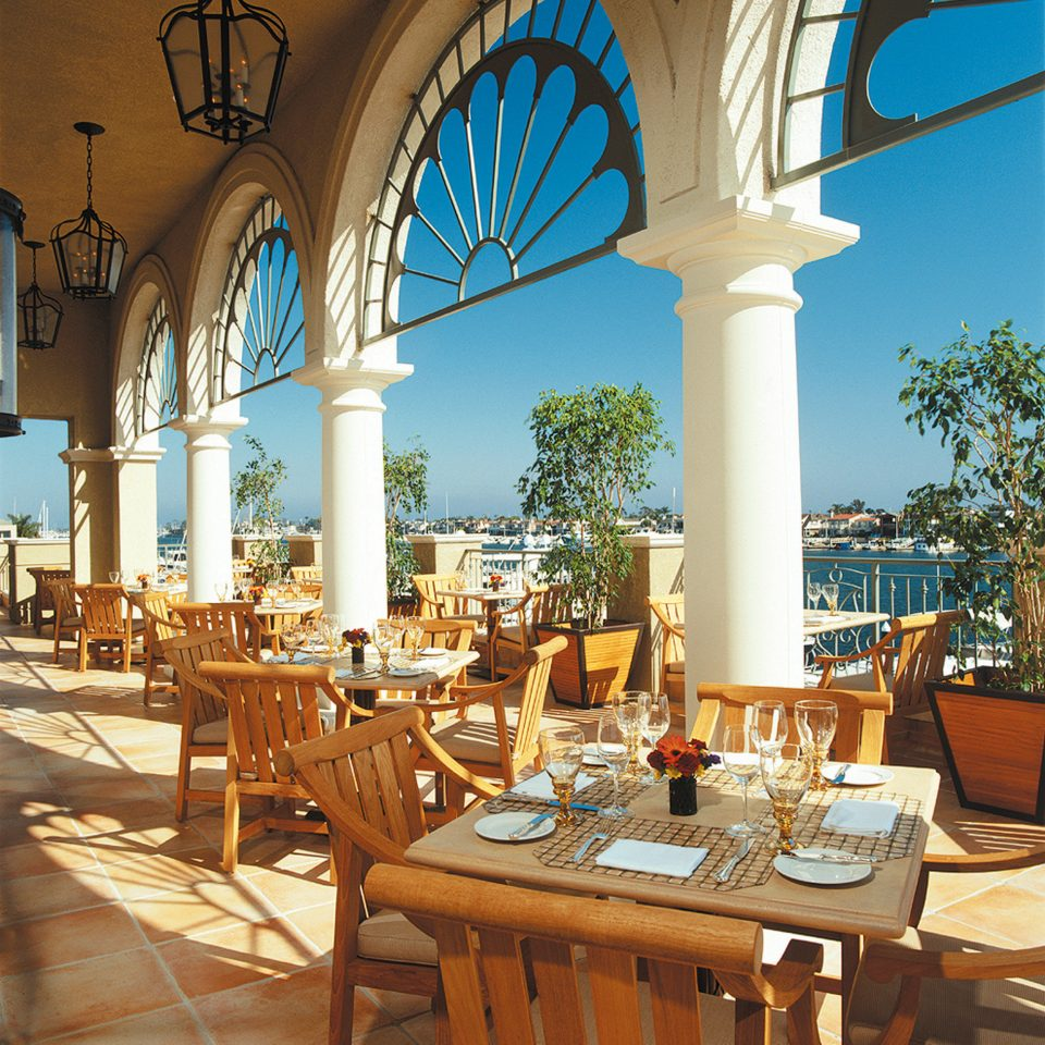 Classic Dining Drink Family Outdoors Resort Romantic Waterfront chair property hacienda home Villa restaurant arch mansion palace set colonnade