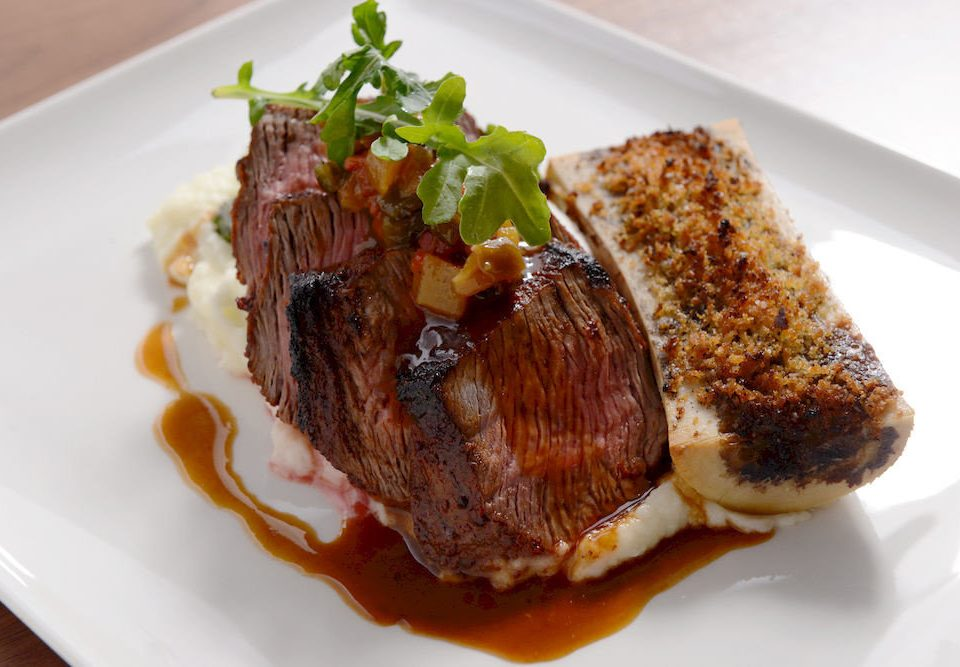 Classic Dining Eat Resort plate food piece meat white slice steak sirloin steak cuisine roasting beef tenderloin rib eye steak animal source foods pork chop lamb and mutton square piece de resistance
