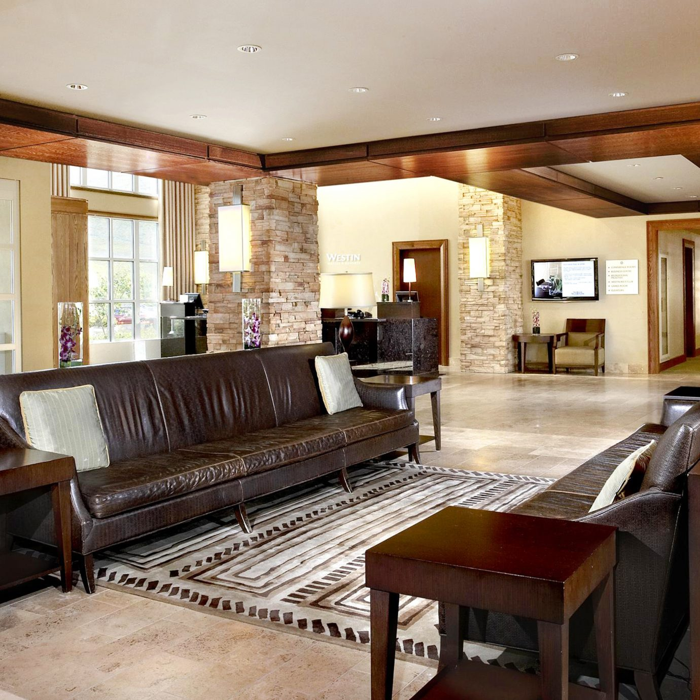 Classic Family Lobby Lounge Resort property living room home Kitchen hardwood cabinetry recreation room condominium mansion Dining wood flooring Suite Villa cottage Island