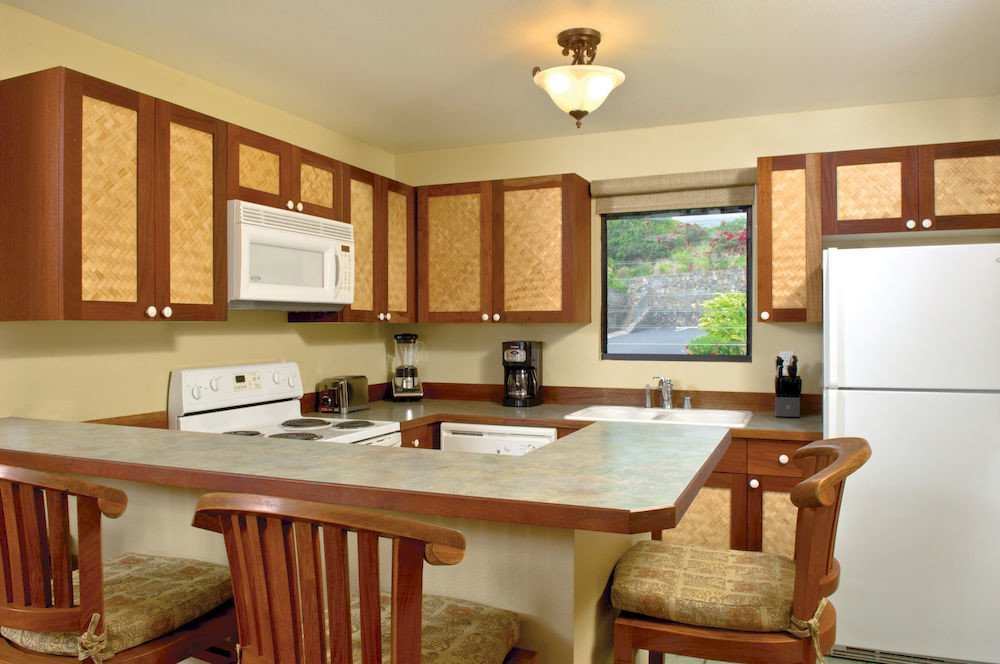 Classic Kitchen Resort property home wooden cottage hardwood countertop cuisine classique cabinetry farmhouse Dining Villa Island dining table