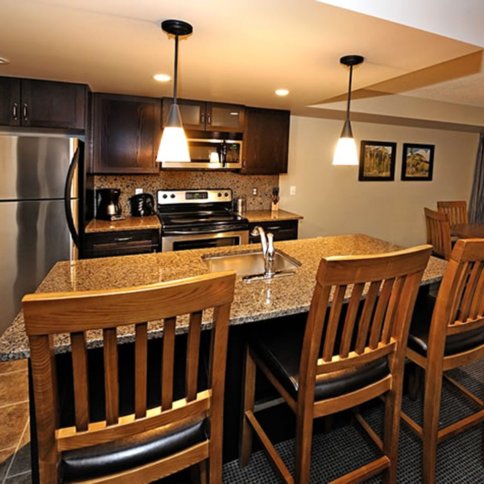 Classic Kitchen Resort chair property Dining home hardwood wooden cottage cabinetry Suite Modern dining table surrounded