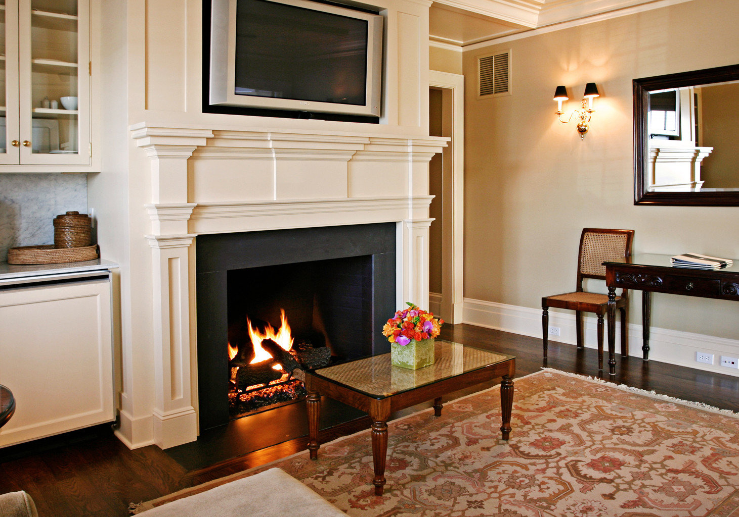 Classic Elegant Fireplace Luxury Suite Waterfront property living room fire home hardwood hearth cuisine classique cottage cabinetry wood flooring Kitchen flooring flat
