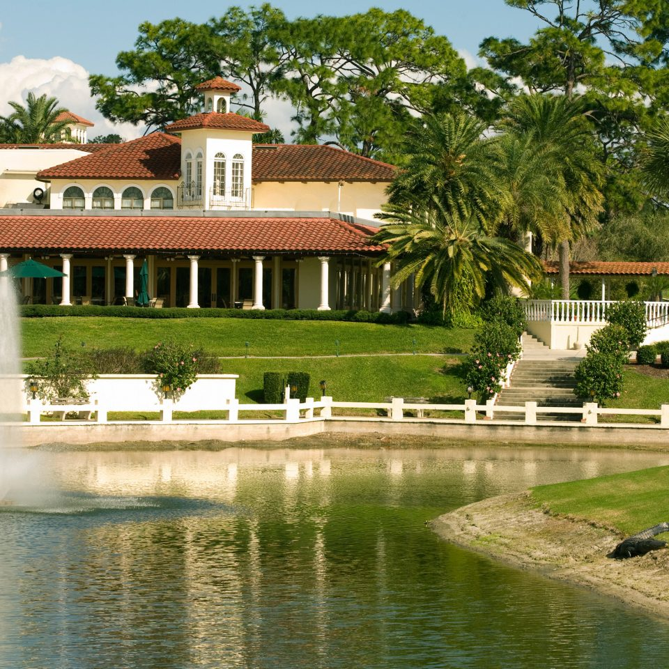 Classic Exterior Resort Waterfront tree sky house swimming pool reflecting pool home palace Garden Nature waterway mansion water feature surrounded