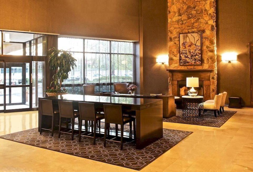 Classic Family Lobby property living room hardwood home hearth flooring wood flooring Fireplace Villa mansion