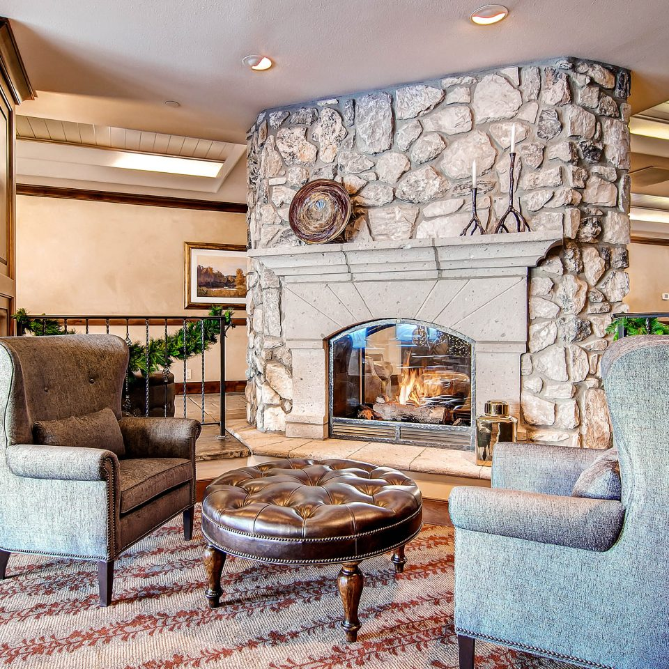 Classic Fireplace Lodge Lounge Outdoor Activities Resort Ski chair property living room home hardwood mansion cottage farmhouse Kitchen