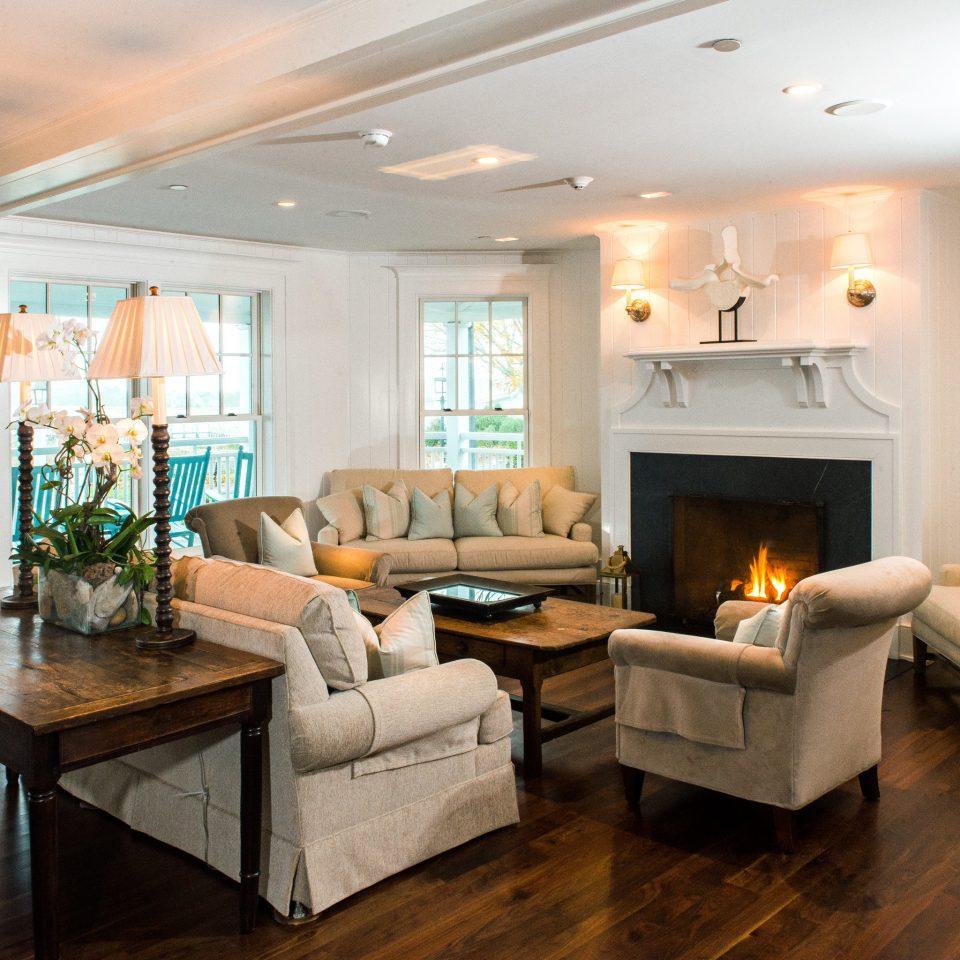 Classic Fireplace Lounge Waterfront sofa living room property home hardwood condominium