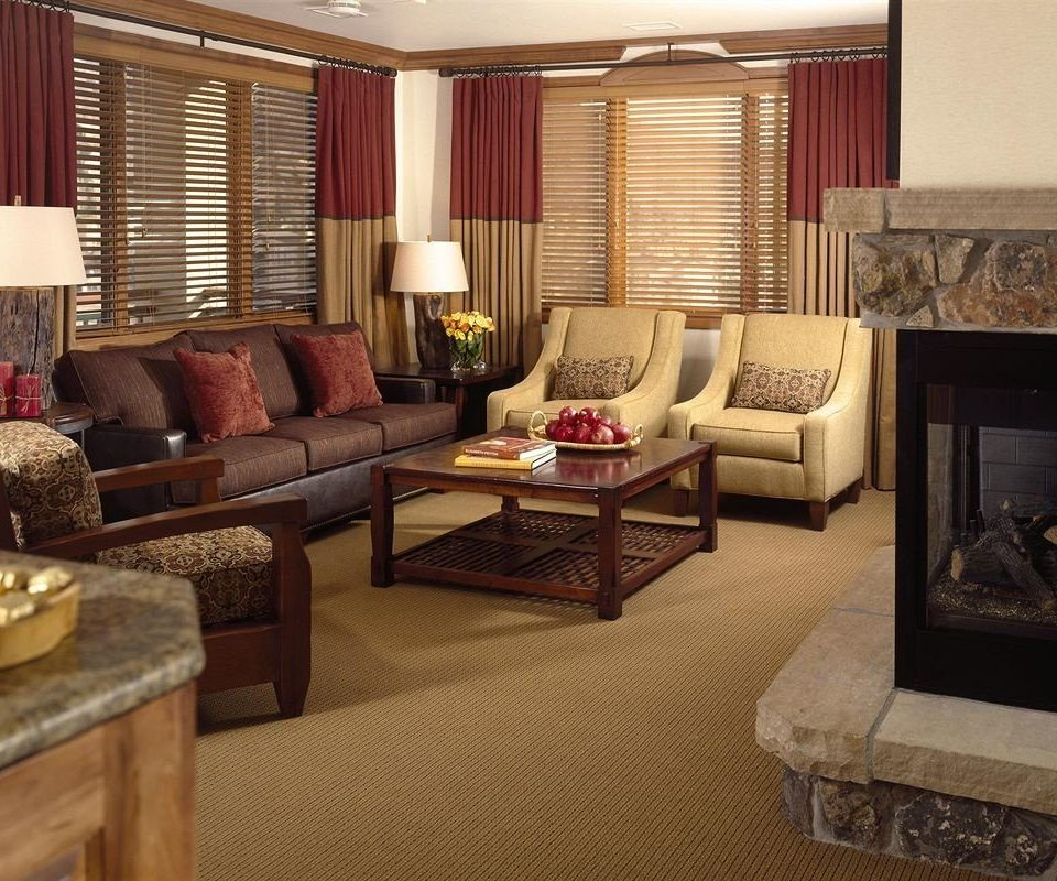 Classic Fireplace Resort sofa living room property Suite home condominium cottage flat leather