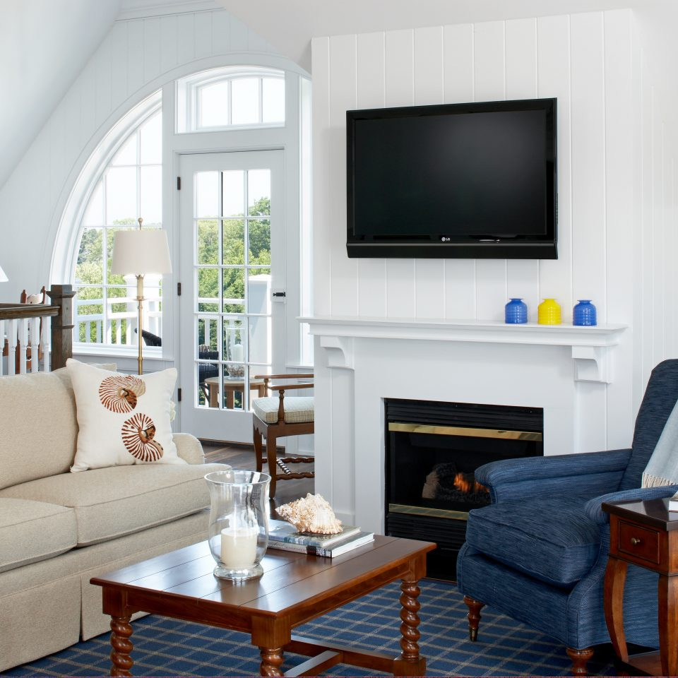 Classic Fireplace Waterfront sofa living room property home hardwood cottage Suite condominium leather flat