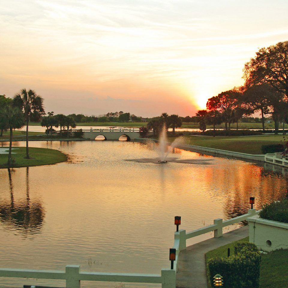 Classic Garden Grounds Resort Waterfront water sky tree River bridge traveling morning Lake Sunset evening waterway dusk rural area reservoir pond passing moving