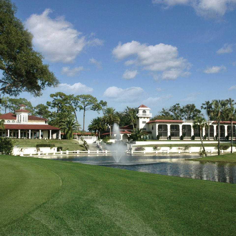 Classic Garden Grounds Resort Waterfront sky grass tree structure building sport venue reflecting pool green lawn home waterway swimming pool mansion palace day