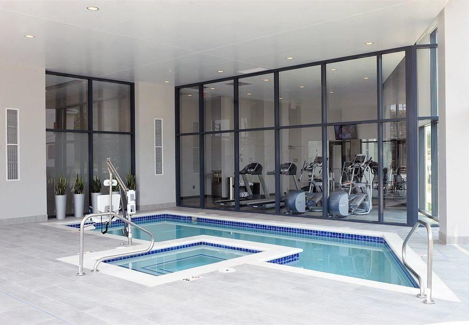 Classic Hot tub/Jacuzzi Pool property building swimming pool leisure centre condominium flooring headquarters blue Resort