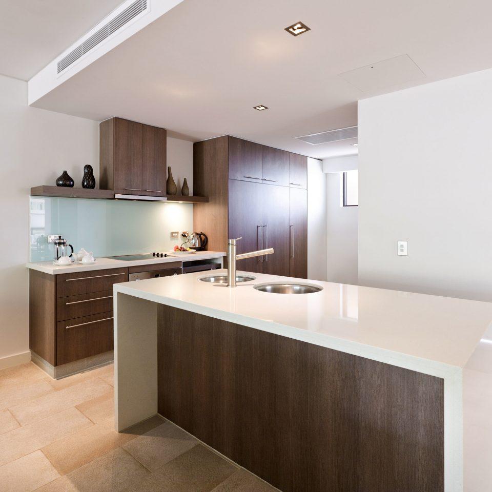 Classic Kitchen Resort property counter hardwood home cuisine classique cabinetry countertop flooring wood flooring appliance