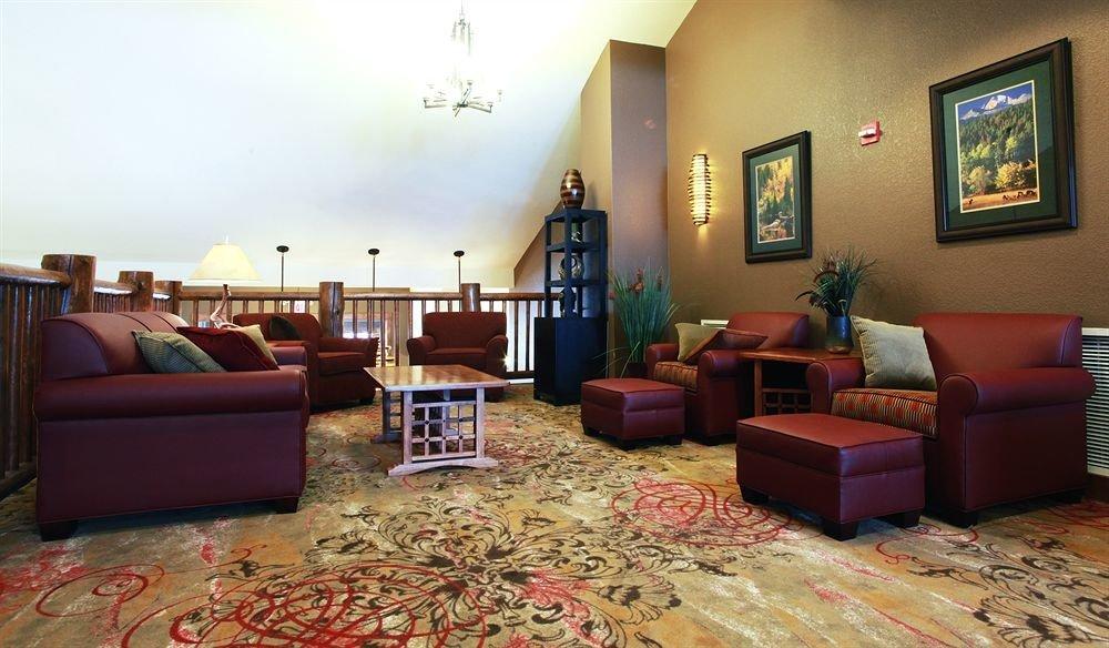 Classic Lounge Resort sofa living room property red rug home condominium hardwood Lobby cottage flooring