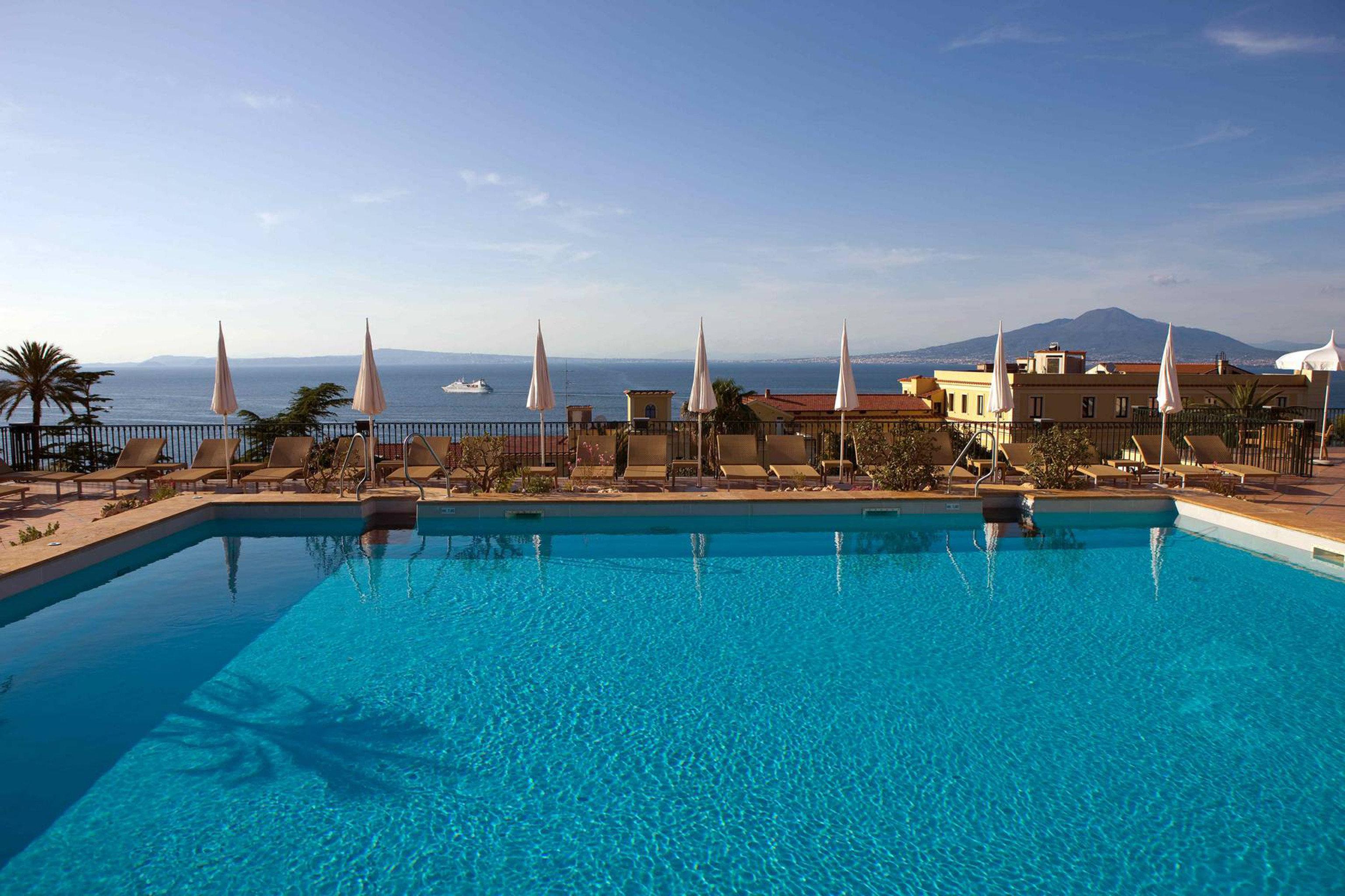 Classic Pool Scenic views Sea sky water swimming pool property chair leisure Resort Ocean blue water sport Villa marina swimming reef day