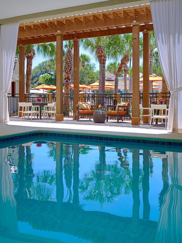 Classic Pool Resort property swimming pool house home