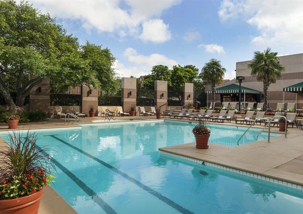 Classic Pool tree swimming pool property Resort leisure Villa condominium resort town backyard plant