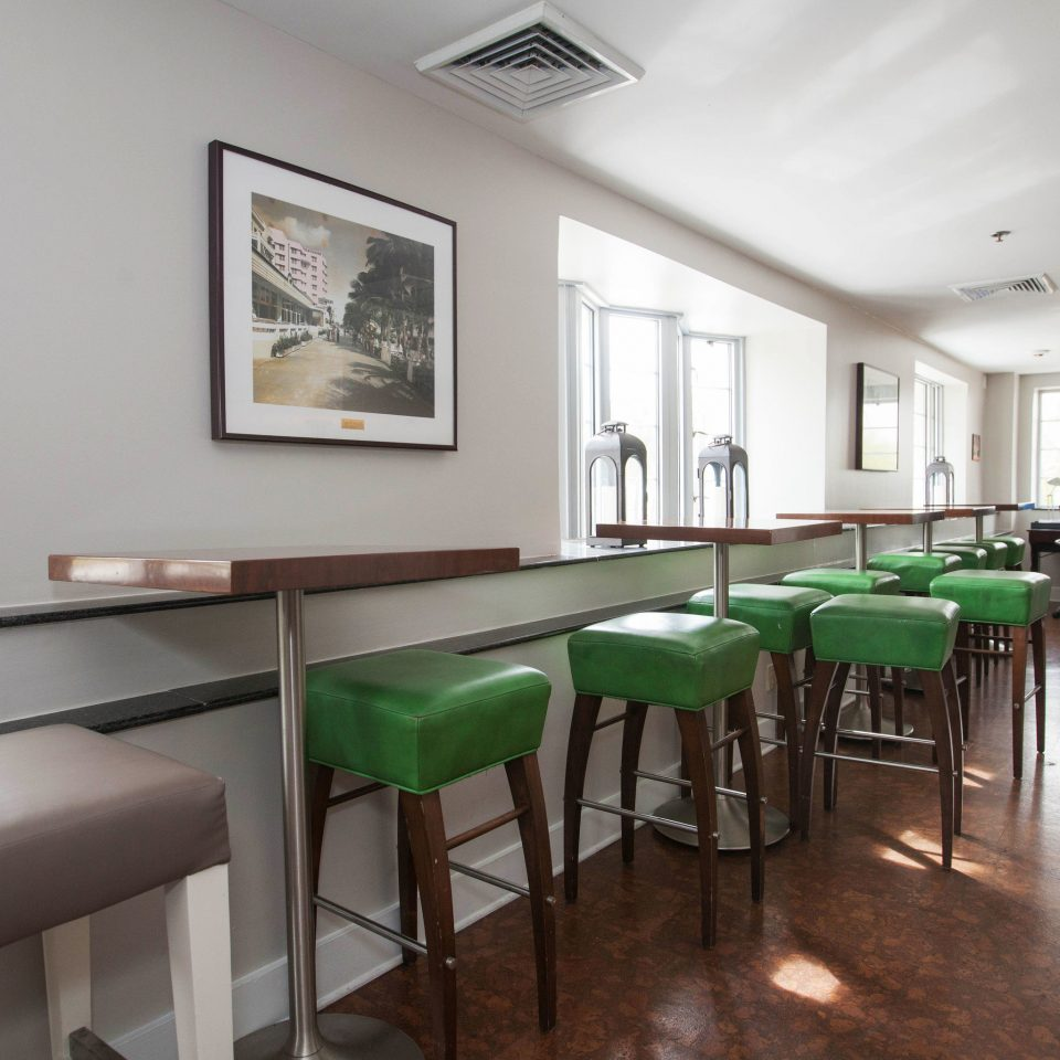 property green condominium waiting room classroom leather dining table