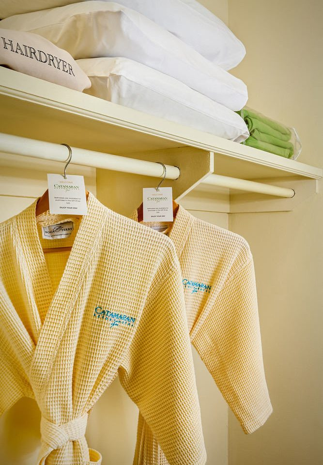 clothing yellow product outerwear dress sweater rack
