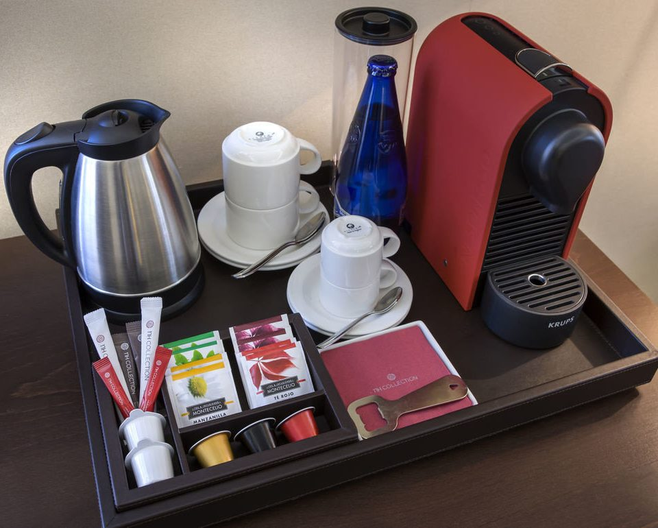 coffee cup product desk items small appliance cluttered