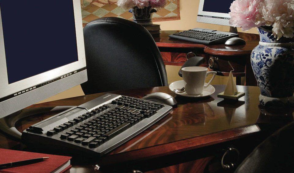 computer desk electronics laptop desktop cluttered